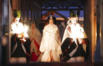 Japan's Empress Masako, center, walks toward Yukiden, one of two main halls of the shrine, where Emperor Naruhito attends Daijosai, or great thanksgiving festival, at the Imperial Palace in Tokyo Thursday, Nov. 14, 2019. Naruhito performed a secretive and controversial ritual Thursday, a once-in-a-reign event to give thanks for good harvests, pray for the peace and safety of the nation and play host to his family's ancestral gods. (Kyodo News via AP)
