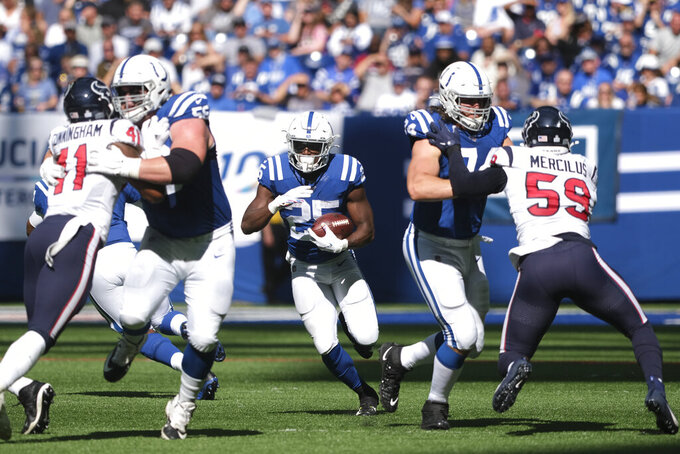 Indianapolis Colts running back Marlon Mack (25) runs during the first half of an NFL football game against the Houston Texans, Sunday, Oct. 20, 2019, in Indianapolis. (AP Photo/AJ Mast)