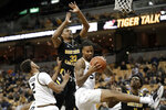 Missouri's Mitchell Smith, right, grabs a rebound in front of teammate Tray Jackson (2) and Northern Kentucky's Dantez Walton (32) during the first half of an NCAA college basketball game Friday, Nov. 8, 2019, in Columbia, Mo. (AP Photo/Jeff Roberson)