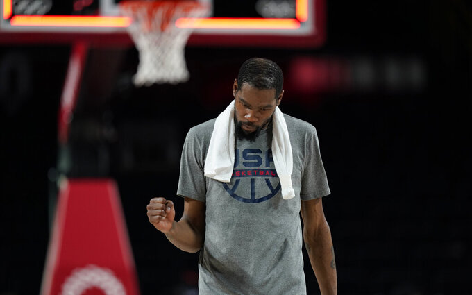 United States's Kevin Durant (7) celebrates their win in the men's basketball semifinal game against Australia at the 2020 Summer Olympics, Thursday, Aug. 5, 2021, in Saitama, Japan. (AP Photo/Charlie Neibergall)