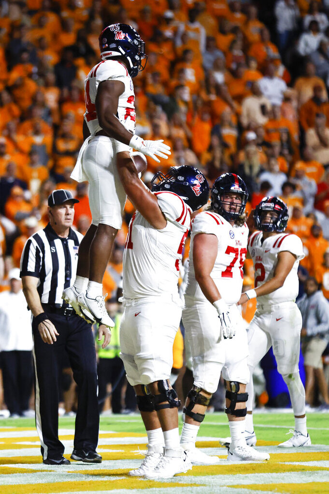 Mississippi running back Snoop Conner (24) is lifted by offensive lineman Orlando Umana (51) after scoring a touchdown during the first half of the team's NCAA college football game against Tennessee on Saturday, Oct. 16, 2021, in Knoxville, Tenn. (AP Photo/Wade Payne)