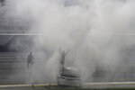 William Byron stands on his car in his burnout smoke after winning the NASCAR Cup Series auto race at Daytona International Speedway, Saturday, Aug. 29, 2020, in Daytona Beach, Fla. (AP Photo/Terry Renna)