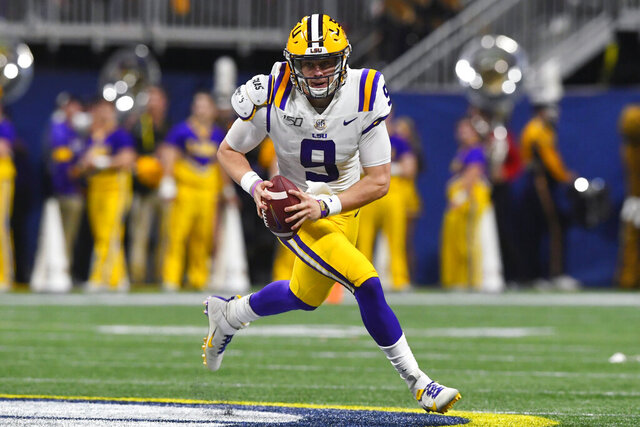 FILE - In this Dec. 7, 2019, file photo, LSU quarterback Joe Burrow (9) runs down field against Georgia during the first half of the Southeastern Conference championship NCAA college football game in Atlanta. Burrow is expected to be a first round pick at the NFL Draft on Thursday, April 23, 2020.(AP Photo/John Amis)