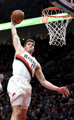 Portland Trail Blazers forward Meyers Leonard goes up for a dunk during the second half of the team's NBA basketball game against the Utah Jazz in Portland, Ore., Wednesday, Jan. 30, 2019. (AP Photo/Steve Dykes)