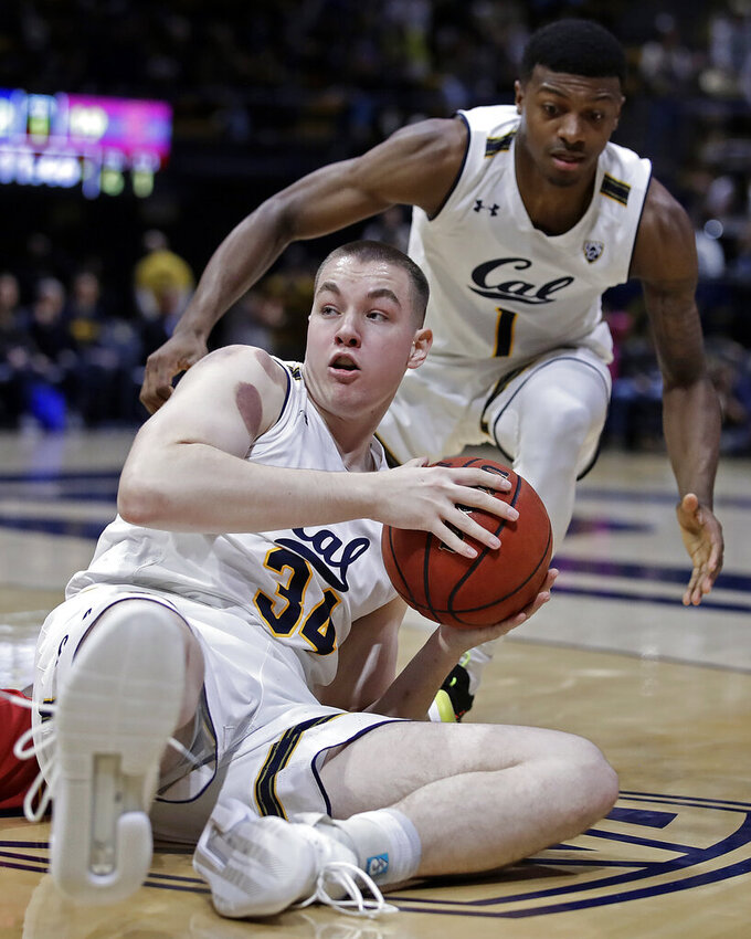 California's Grant Anticevich (34) looks to pass from the floor during the first half of an NCAA college basketball game against Southern California on Saturday, Feb. 16, 2019, in Berkeley, Calif. (AP Photo/Ben Margot)