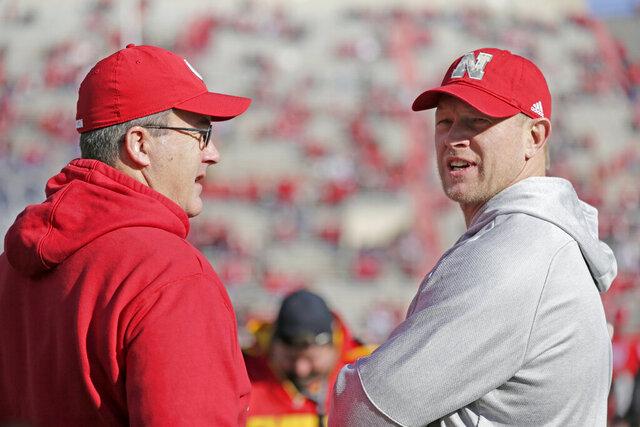 Nebraska head coach Scott Frost, right, and Wisconsin head coach Paul Chryst talk before an NCAA college football game in Lincoln, Neb., Saturday, Nov. 16, 2019. (AP Photo/Nati Harnik)