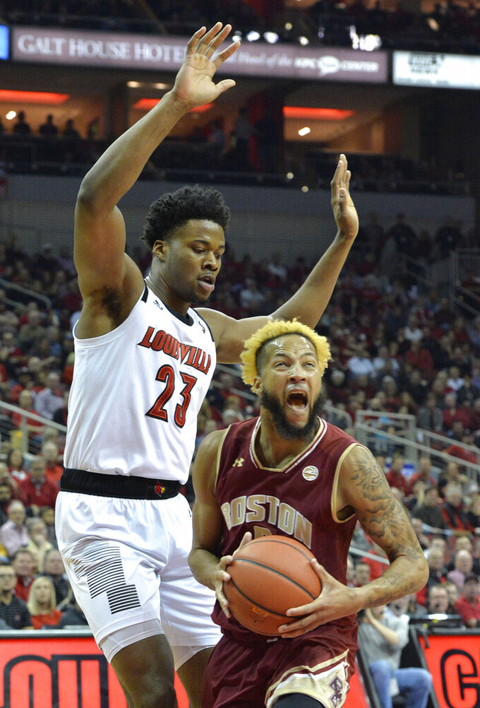 Boston College guard Ky Bowman (0) looks for help from the defense of Louisville center Steven Enoch (23) during the first half of an NCAA college basketball game in Louisville, Ky., Wednesday, Jan. 16, 2019. (AP Photo/Timothy D. Easley)