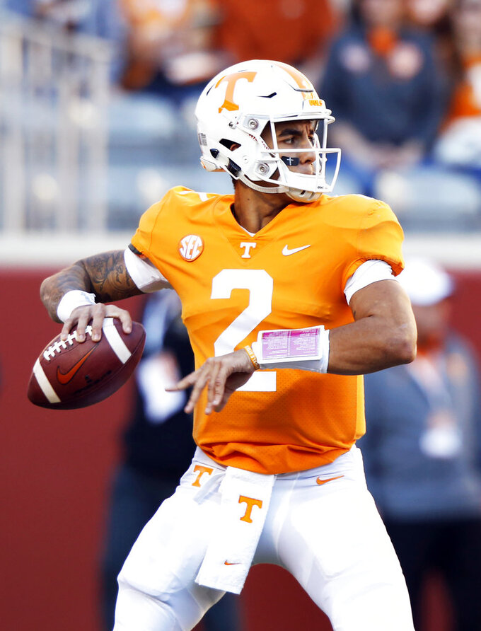 Tennessee quarterback Jarrett Guarantano (2) throws during warmups before an NCAA college football game against Missouri Saturday, Nov. 17, 2018, in Knoxville, Tenn. (AP Photo/Wade Payne)