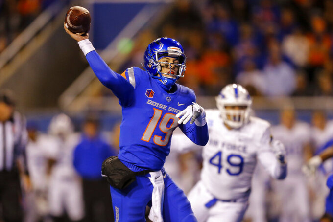 Boise State quarterback Hank Bachmeier throws a pass against Air Force during the first half of an NCAA college football game Saturday, Oct. 16, 2021, in Boise, Idaho. (AP Photo/Steve Conner)