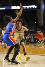 Vanderbilt guard Scotty Pippen Jr. (2) drives as he is defended by Florida guard Ques Glover (0) during an NCAA college basketball game Saturday, Feb. 1, 2020, in Nashville, Tenn. (Wade Payne/The Tennessean via AP)