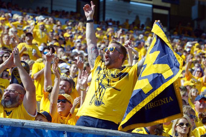 West Virginia fans cheer during the first half of an NCAA college football game against Kansas in Morgantown, W. Va., Saturday Oct. 6, 2018. (Craig Hudson/Charleston Gazette-Mail via AP)