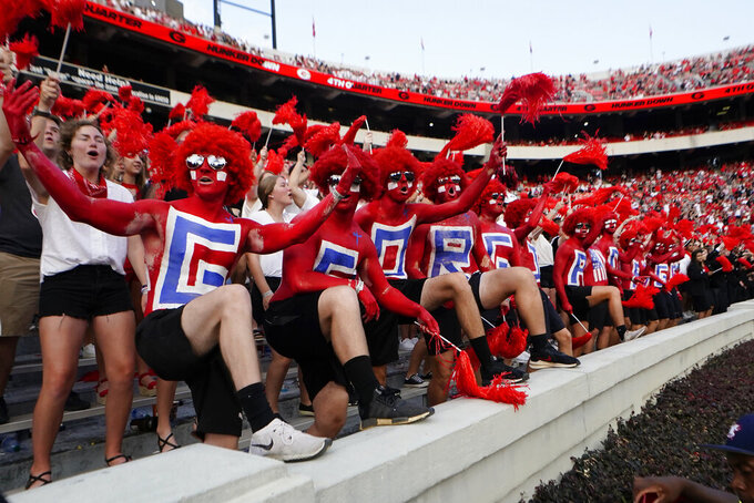 Georgia fans cheer on the Bulldogs during the second half of a an NCAA college football game against UAB, Saturday, Sept. 11, 2021, in Athens, Ga. (AP Photo/John Bazemore)