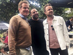 Breaking bad actors Bryan Cranston, left, and and Aaron Paul, right, pose for a photo with nightlife guru David Grumman, center, at the Swan restaurant in Miami's design district, Saturday, Feb. 22, 2020 They were at a soul food brunch Saturday hosted by Grammy Award winning singer Pharrell, that was part of the South Beach Wine & Food Festival. (AP Photo/Kelli Kennedy)