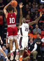 Illinois guard Da'Monte Williams (20) defends against a shot from Indiana guard Rob Phinisee (10) during the first half of an NCAA college basketball game in Champaign, Ill., Thursday, March 7, 2019. (AP Photo/Stephen Haas)