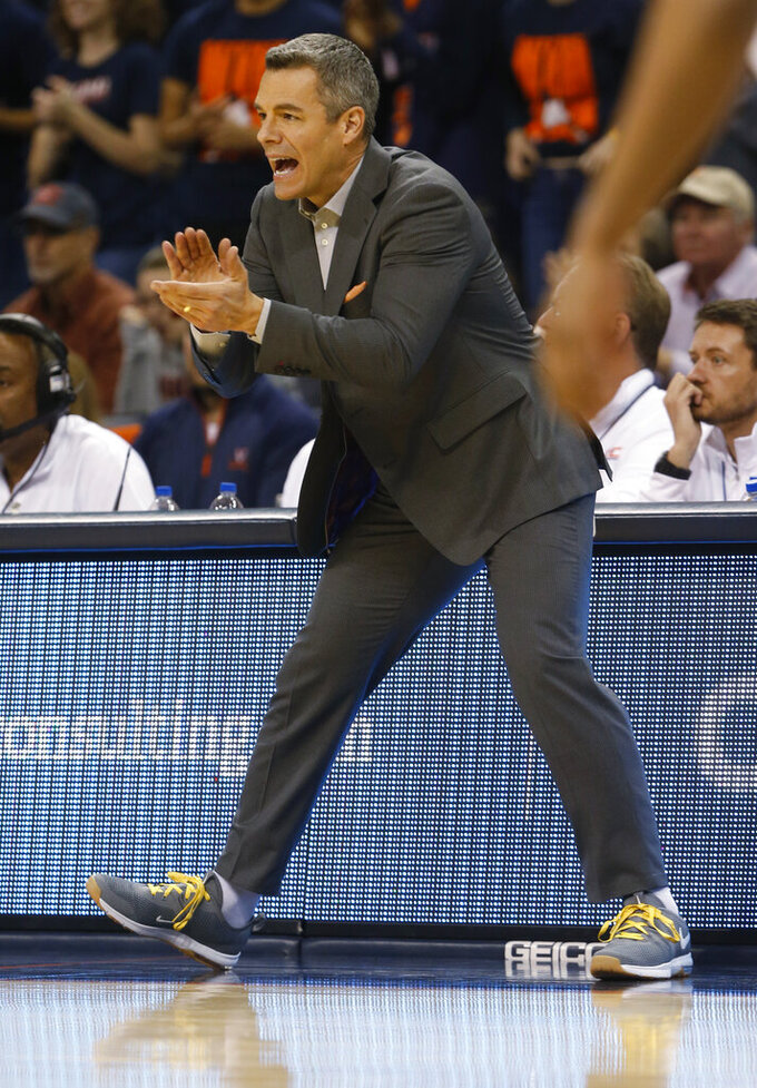 Virginia head coach Tony Bennett directs his team during the first half of an NCAA college basketball game in Charlottesville, Va., Tuesday, Jan. 22, 2019. (AP Photo/Steve Helber)