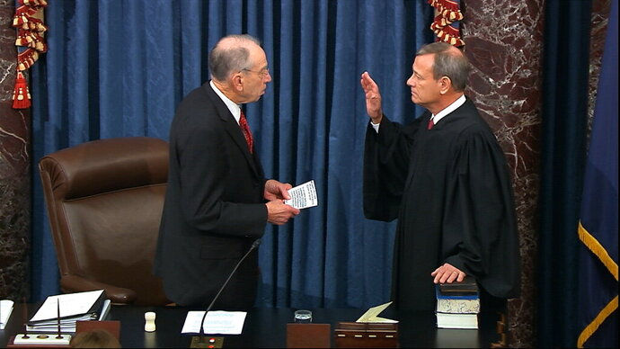 In this image from video, President Pro Tempore of the Senate Sen. Chuck Grassley, R-Iowa., swears in Supreme Court Chief Justice John Roberts as the presiding officer for the impeachment trial of President Donald Trump in the Senate at the U.S. Capitol in Washington, Thursday, Jan. 16, 2020. (Senate Television via AP)