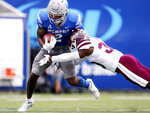 Memphis running back Rodrigues Clark (2) breaks a tackle by Mississippi State safety Jay Jimison (36) during an NCAA college football game Saturday, Sept. 18, 2021, in Memphis, Tenn. (Patrick Lantrip/Daily Memphian via AP)
