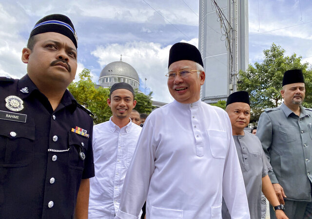 Former Malaysian Prime Minister Najib Razak, center, leaves a mosque in Kuala Lumpur on Friday, Dec. 20, 2019. Najib made a religious oath in a mosque Friday denying a new accusation that he ordered the killing of a Mongolian woman 13 years ago. (AP Photo/Hau Dinh)