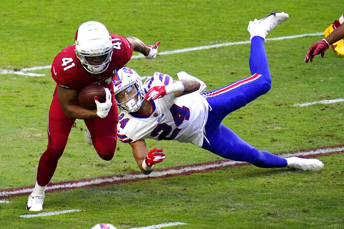 Arizona Cardinals running back Kenyan Drake (41) eludes the tackle of Buffalo Bills cornerback Taron Johnson (24) during the first half of an NFL football game, Sunday, Nov. 15, 2020, in Glendale, Ariz. (AP Photo/Ross D. Franklin)