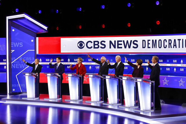 From left, Democratic presidential candidates, former New York City Mayor Mike Bloomberg, former South Bend Mayor Pete Buttigieg, Sen. Elizabeth Warren, D-Mass., Sen. Bernie Sanders, I-Vt., former Vice President Joe Biden, Sen. Amy Klobuchar, D-Minn., and businessman Tom Steyer, participate in a Democratic presidential primary debate at the Gaillard Center, Tuesday, Feb. 25, 2020, in Charleston, S.C., co-hosted by CBS News and the Congressional Black Caucus Institute. (AP Photo/Patrick Semansky)