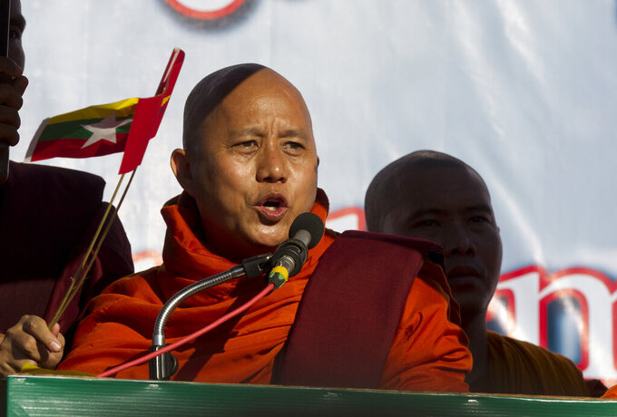 FILE - In this Sunday, Oct. 14, 2018 file photo, Buddhist monk and anti-Muslim community leader Wirathu speaks during a pro-military rally in front of city hall in Yangon, Myanmar. A ultranationalist Buddhist monk notorious for his anti-Muslim remarks was freed from prison Monday, Sept. 6, 2021 after charges that he tried to stir up disaffection against Myanmar's previous civilian government were dropped. News of the release of Wirathu was reported by People Media, an online newsite, which said on Facebook that it had received confirmation from Maj. Gen. Zaw Min Tun, a spokesman for the Myanmar military, also known as the Tatmadaw. (AP Photo/Thein Zaw, file)