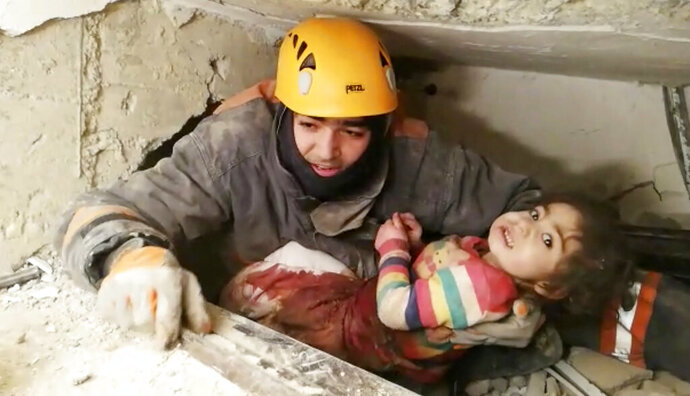 In this image taken from video made available by Ankara Municipality Fire Department shows a rescuer pulling out a girl from the rubble of a collapsed building, in Elazig, Turkey, Saturday Jan. 25, 2020. A two-year-old girl and her mother were pulled from the rubble of an apartment building on Saturday more than 24 hours after an earthquake struck eastern Turkey. Various earthquake monitoring centres gave magnitudes of the quake ranging from 6.5 to 6.8. (Ankara Municipality Fire Department via AP)