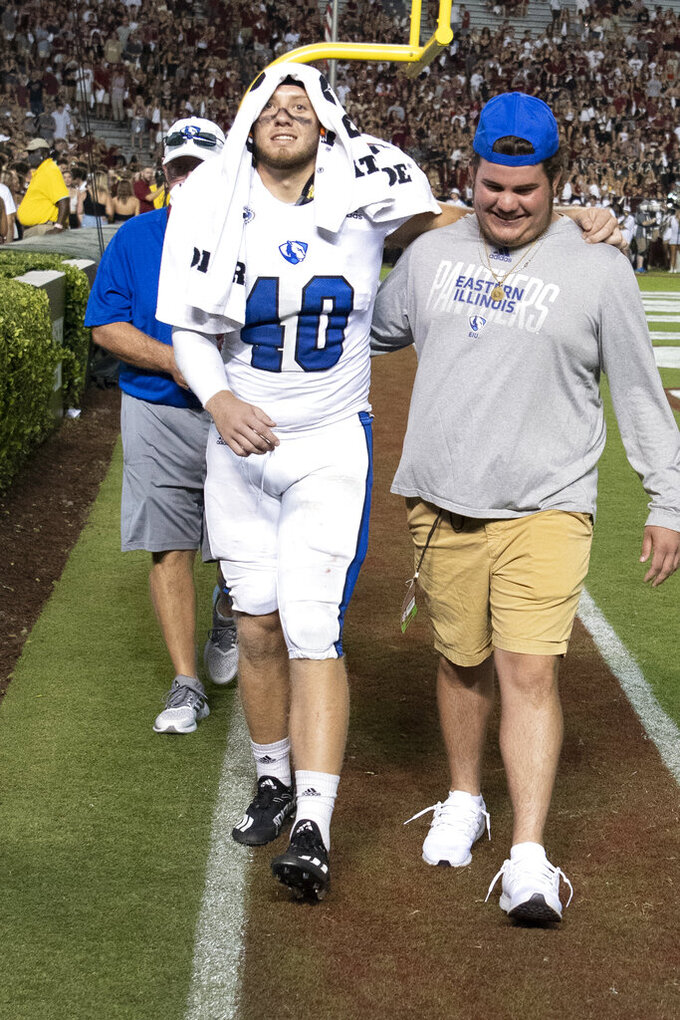 Eastern Illinois linebacker Phoenix Porter (40) is helped to the locker room during the first half of an NCAA college football game against South Carolina, Saturday, Sept. 4, 2021, in Columbia, S.C. (AP Photo/Hakim Wright Sr.)