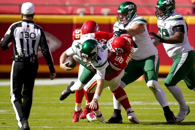 New York Jets quarterback Sam Darnold (14) is sacked by Kansas City Chiefs defensive tackle Tershawn Wharton (98) in the first half of an NFL football game on Sunday, Nov. 1, 2020, in Kansas City, Mo. (AP Photo/Jeff Roberson)
