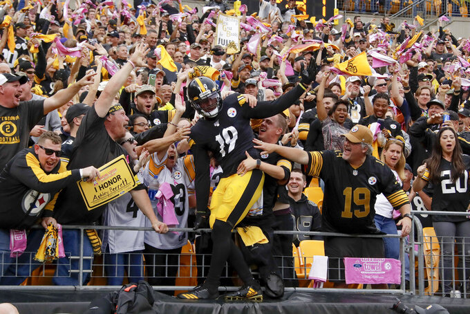 Pittsburgh Steelers wide receiver JuJu Smith-Schuster (19) celebrates with fans after scoring a touchdown in the first half of an NFL football game against the Baltimore Ravens, Sunday, Oct. 6, 2019, in Pittsburgh. (AP Photo/Don Wright)