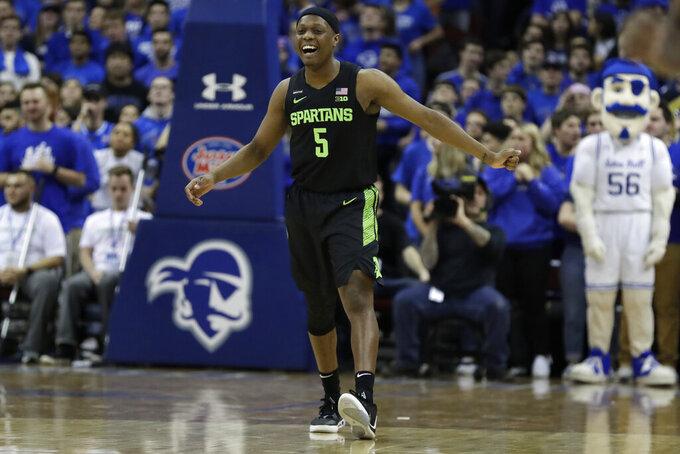 Michigan State guard Cassius Winston (5) reacts after making a basket during the first half of an NCAA college basketball game against Seton Hall on Thursday, Nov. 14, 2019, in Newark, N.J. (AP Photo/Adam Hunger)