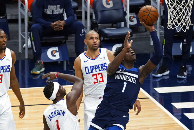 Minnesota Timberwolves' Anthony Edwards (1) shoots as Los Angeles Clippers' Reggie Jackson (1) and Nicolas Batum (33) watch during the first half of an NBA basketball game Wednesday, Feb. 10, 2021, in Minneapolis. (AP Photo/Jim Mone)