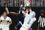 Georgia Tech wide receiver Malachi Carter (7) makes a catch for a touchdown as North Carolina defensive back Kyler McMichael (1) defends during the second half of an NCAA college football game, Saturday, Sept. 25, 2021, in Atlanta. (AP Photo/John Bazemore)