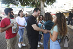 FILE - In this Aug. 29, 2019 file photo, Ayman Odeh, the leader of the Arab Joint List parties, meets constituents in Nazareth, Israel. Israel heads to the polls on Tuesday for the second time this year. For this election, Israel's Arab parties, which represent the country's 20% minority, have mended fences and will run as a single faction. (AP Photo/Mahmoud Illean, File)