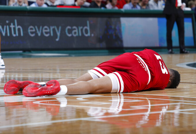 Indiana's Juwan Morgan lies on the court after being injured during the first half of an NCAA college basketball game against Michigan State, Saturday, Feb. 2, 2019, in East Lansing, Mich. (AP Photo/Al Goldis)