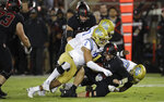 UCLA's Josh Woods (2) and Odua Isibor sack Stanford quarterback Jack West during the second half of an NCAA college football game Thursday, Oct. 17, 2019, in Stanford, Calif. (AP Photo/Ben Margot)