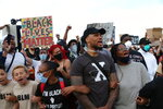 Portland Trailblazers' Damian Lillard, second from right, joins other demonstrators in Portland, Ore., during a protest against police brutality and racism sparked by the death of George Floyd, who died May 25 after being restrained by police in Minneapolis. (AP Photo/Craig Mitchelldyer)