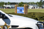 A police vehicle sits outside the Lee Correctional Institution on Monday, April 16, 2018, in Bishopville, S.C. Multiple inmates were killed and others seriously injured amid fighting between prisoners inside the maximum security prison in South Carolina. (AP Photo/Sean Rayford)