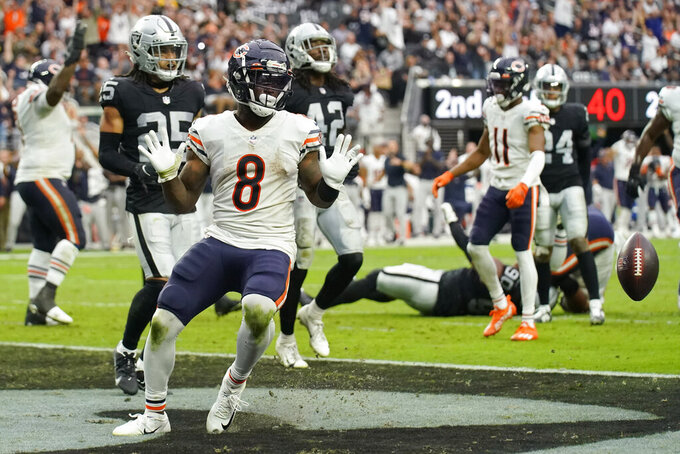 Chicago Bears running back Damien Williams (8) reacts after scoring at touchdown against the Las Vegas Raiders during the first half of an NFL football game, Sunday, Oct. 10, 2021, in Las Vegas. (AP Photo/Rick Scuteri)
