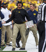 Michigan head coach Jim Harbaugh reacts to a sideline referee in the first quarter of an NCAA college football game against Maryland in Ann Arbor, Mich., Saturday, Oct. 6, 2018. (AP Photo/Tony Ding)