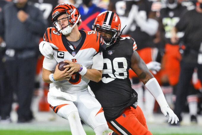 Cleveland Browns defensive tackle Sheldon Richardson (98) sacks Cincinnati Bengals quarterback Joe Burrow (9) during the first half of an NFL football game Thursday, Sept. 17, 2020, in Cleveland. (AP Photo/David Richard)