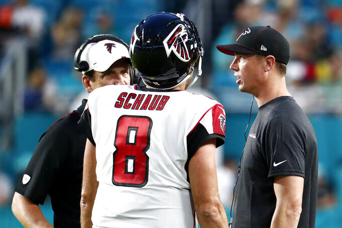 Atlanta Falcons quarterback Matt Schaub (8) talks with quarterback Matt Ryan, right, during the first half of the team's preseason NFL football game against the Miami Dolphins, Thursday, Aug. 8, 2019, in Miami Gardens, Fla. (AP Photo/Brynn Anderson)