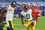 Pittsburgh Steelers wide receiver James Washington (13) celebrates with JuJu Smith-Schuster (19) after scoring on a 19-yard pass play with Buffalo Bills cornerback Levi Wallace defending during the first half of an NFL football game in Orchard Park, N.Y., Sunday, Dec. 13, 2020. (AP Photo/Adrian Kraus)