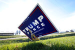 A sign in support of President Donald Trump is seen in the yard of Jasper County Republican Party chairman Thad Nearmyer, Thursday, Nov. 19, 2020, near Monroe, Iowa.