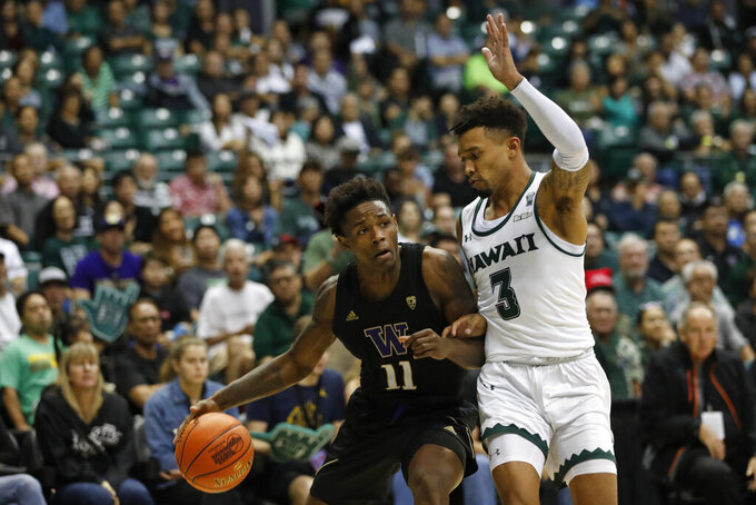 Washington guard Nahziah Carter (11) is defended by Hawaii guard Eddie Stansberry (3) during the second half of an NCAA college basketball game Monday, Dec. 23, 2019, in Honolulu. (AP Photo/Marco Garcia)