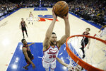 Philadelphia 76ers' Ben Simmons goes up for a dunk during the first half of an NBA basketball game against the Chicago Bulls, Friday, Jan. 17, 2020, in Philadelphia. (AP Photo/Matt Slocum)