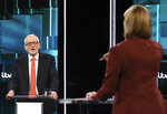 In this photo issued by ITV, Jeremy Corbyn during their election head-to-head debate live on TV, with debate adjudicator Julie Etchingham, right, in Manchester, England, Tuesday, Nov. 19, 2019.  Prime Minister Boris Johnson and leader of the opposition Labour Party Jeremy Corbyn are set to go head-to-head in their first live televised debate Tuesday evening, as the UK prepares for a General Election on Dec. 12. (ITV via AP)