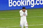 England's Jadon Sancho reacts after missing a chance to score during the penalty shoot out of the Euro 2020 final soccer match between Italy and England at Wembley stadium in London, Sunday, July 11, 2021. (Facundo Arrizabalaga/Pool via AP)