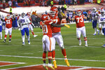 Kansas City Chiefs tight end Travis Kelce celebrates with teammate Tyreek Hill (10) after catching a 5-yard touchdown pass during the second half of the AFC championship NFL football game against the Buffalo Bills, Sunday, Jan. 24, 2021, in Kansas City, Mo. (AP Photo/Reed Hoffmann)