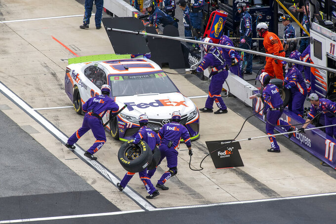 Denny Hamlin  pits at lap 77 at the Drydene 400 - Monster Energy NASCAR Cup Series playoff auto race, Sunday, Oct. 6, 2019, at Dover International Speedway in Dover, Del. (AP Photo/Jason Minto)
