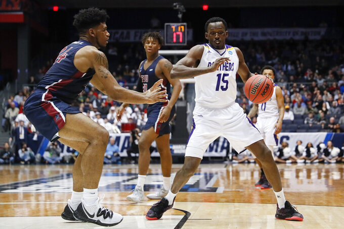 Prairie View A&M's Gerard Andrus (15) drives agianst Fairleigh Dickinson's Mike Holloway Jr., left, during the second half of a First Four game of the NCAA college basketball tournament, Tuesday, March 19, 2019, in Dayton, Ohio. (AP Photo/John Minchillo)